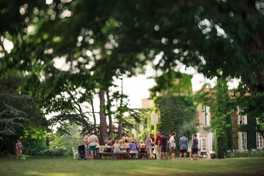 family and friends gathering in grounds of french chateau